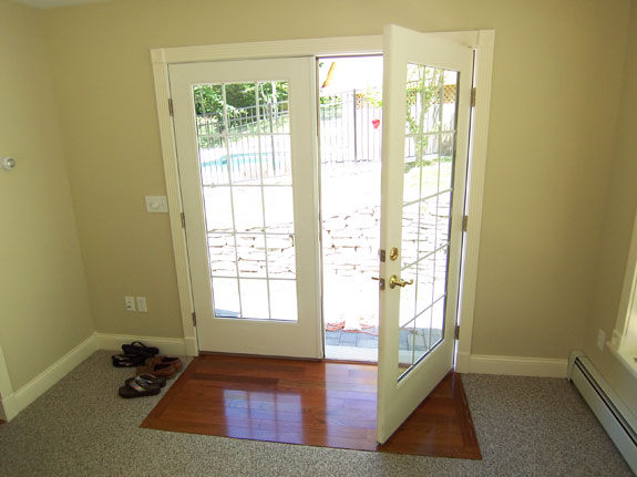 French doors with Hardwood Floor Inlay