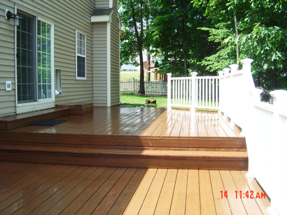 Composite Deck built onto a Colonial Home - Simply Additions