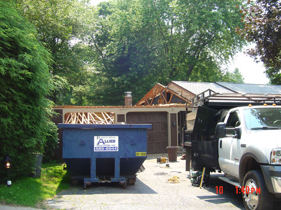 Removal of roof before second story addition